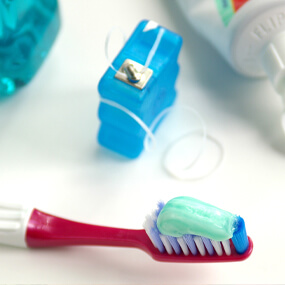 Good oral health begins with a balanced diet and daily brushing and flossing.
