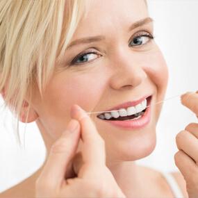 Top reasons regular flossing is integral to good oral health.
