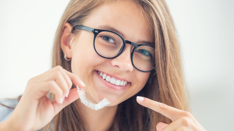 Invisalign clear aligners are the superior alternative to metal braces for many patients and more affordable too!