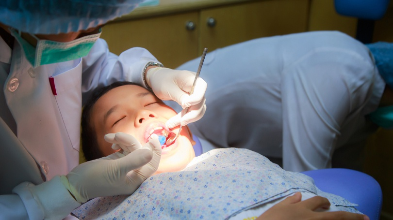 Pit and fissure cavities are most commonly associated with the molars and premolars and can be prevented by applying a dental sealant to the back teeth.