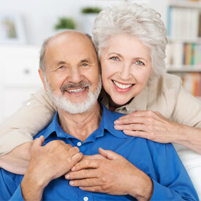 Dentures are more affordable up front, but implants provide many benefits long term.