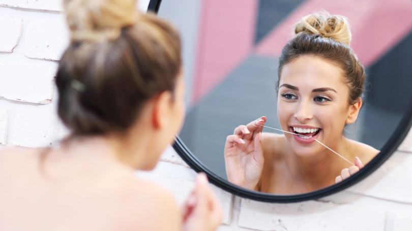 While many people opt to floss after brushing their teeth, many dentists recommend doing it before.