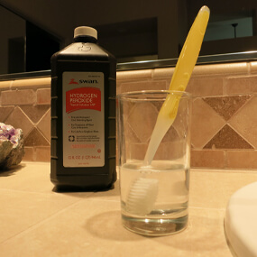 Sanitize your toothbrush to avoid introducing foreign bacteria to your mouth.